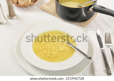 Bowl of chicken noodle soup from a high angle view - stock photo