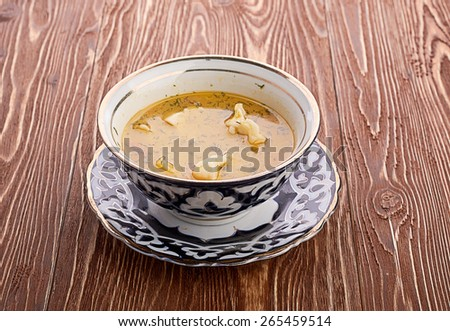 Bowl of chicken soup with vegetables and noodles - stock photo