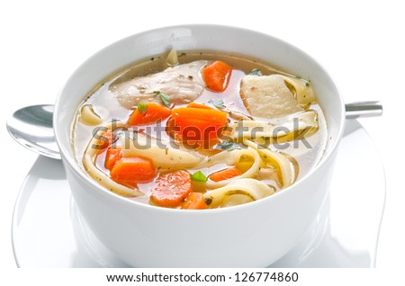 Bowl of chicken soup with vegetables and noodles - saved with clipping path - stock photo