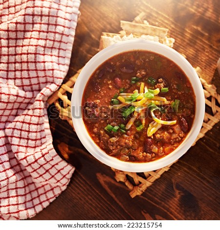 bowl of chili overhead shot with copy space - stock photo