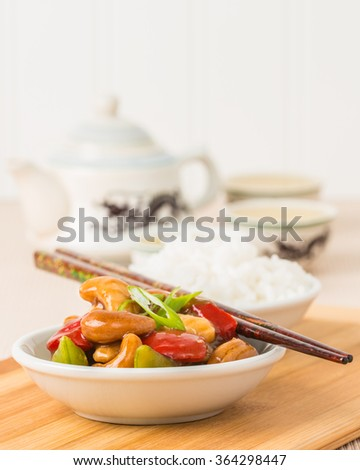 Bowl of Chinese cashew chicken photographed closeup.