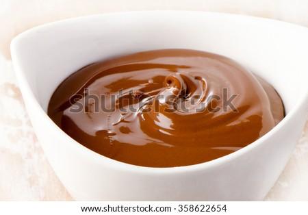 Bowl of chocolate cream. Selective focus - stock photo