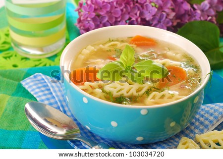 bowl of clear chicken soup with ear shape noodle - stock photo