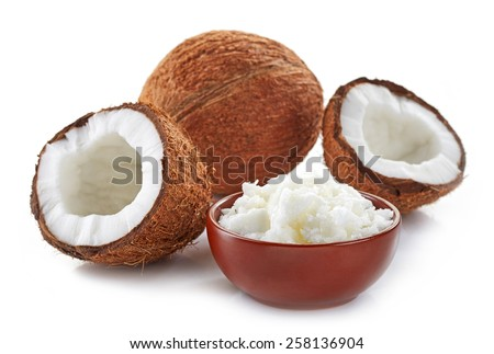 bowl of coconut oil and fresh coconuts isolated on white - stock photo