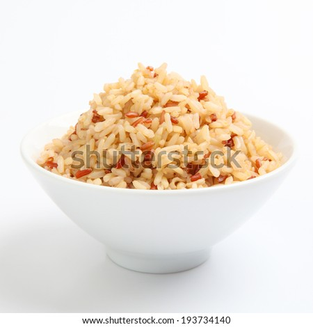 Bowl of cooked mixed rice - stock photo