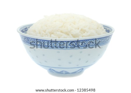 Bowl of cooked rice in isolated white background - stock photo