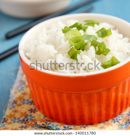 Bowl of cooked rice with green onion - stock photo