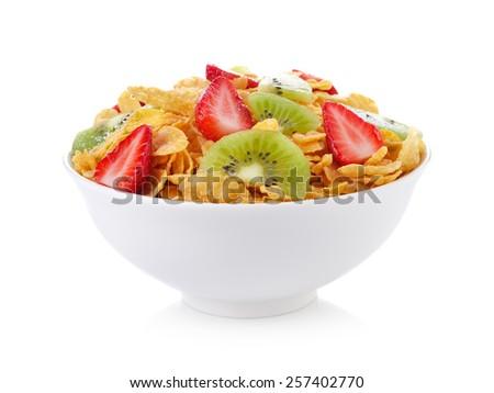 bowl of corn flakes with fruit on white background - stock photo