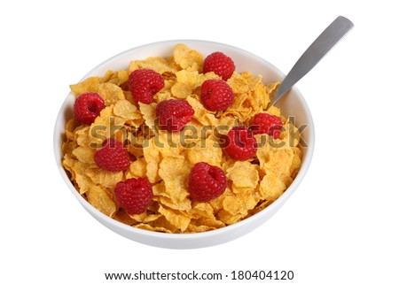 Bowl of corn flakes with raspberries, cut out on white background