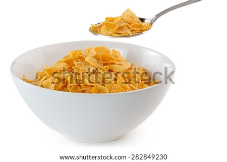 bowl of cornflakes with a spoon on white background - stock photo
