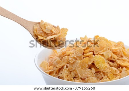 bowl of cornflakes with a spoon on white background. Healthy Eating. breakfast. vegetarianism. - stock photo