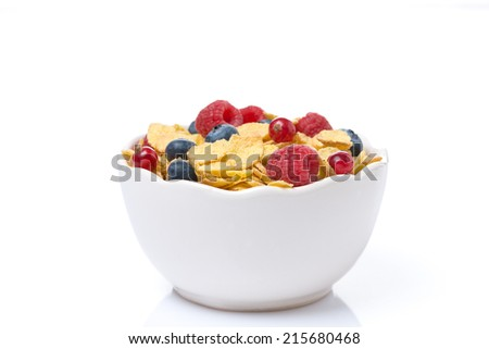 bowl of cornflakes with fresh seasonal berries, isolated on white - stock photo