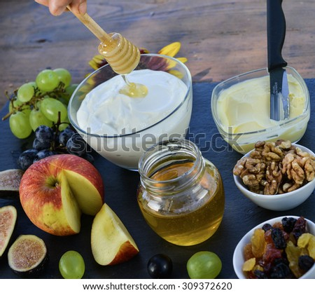 Bowl of cream curd sweetened with honey and fruits