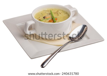 Bowl of cream soup isolated on wooden table - stock photo