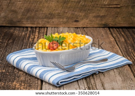 Bowl of creamy homemade macaroni and cheese. - stock photo