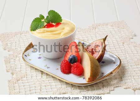 Bowl of creamy pudding and fresh fruit
