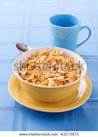bowl of crunchy corn flakes for breakfast - stock photo