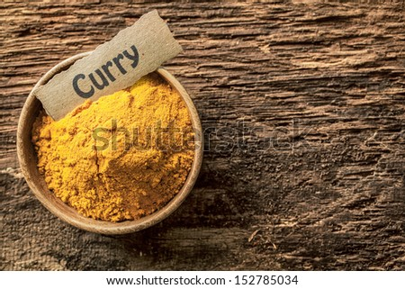 Bowl of curry powder, a traditional blend of masala, turmeric and Asian spices for use as a hot savoury cooking ingredient - stock photo