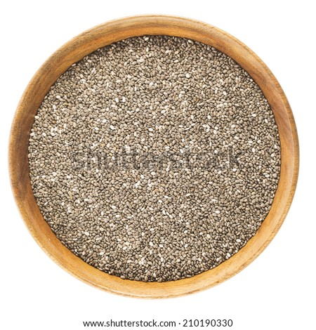 Bowl of dark chia seeds isolated on white background. - stock photo