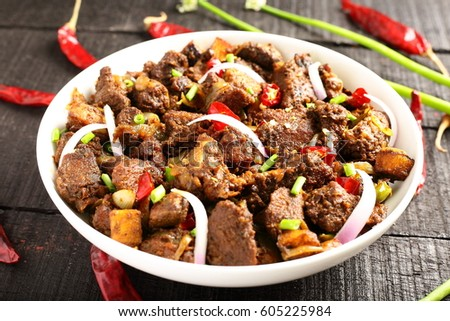 Bowl of delicious lamb roast with vegetables ,from Asian cuisine,