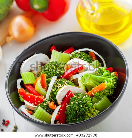 Bowl of delicious salad made of vegetables.  Healthy vegetarian food.