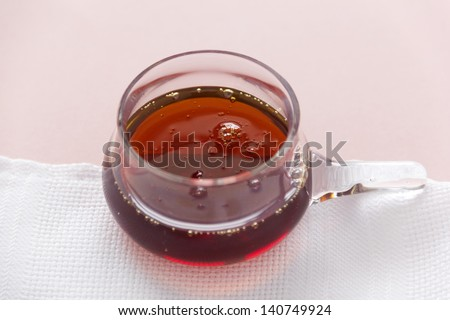 Bowl of delicious thick maple syrup ready for serving as a condiment. - stock photo