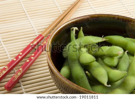 Bowl of edamame with chopsticks - stock photo