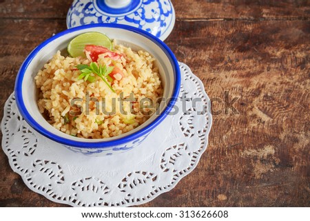 Bowl of egg fried rice on wooden background