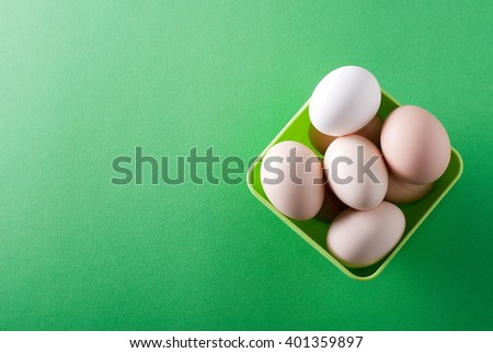 bowl of eggs on a green background