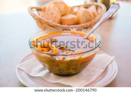 Bowl of fish soup close-up - stock photo