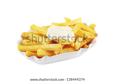 Bowl of french fries topped with mayonnaise isolated on white - stock photo