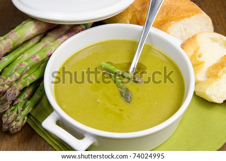 Bowl of fresh asparagus soup - stock photo