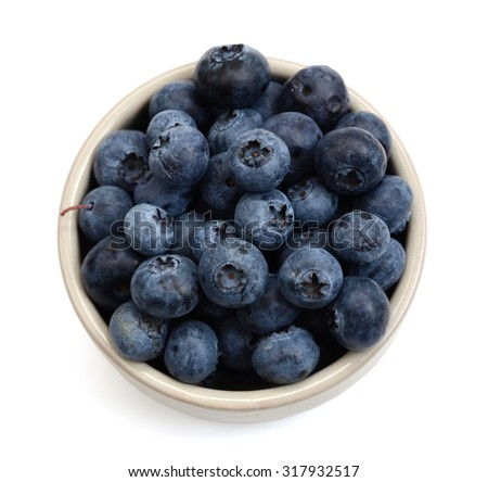 bowl of fresh blueberries on white background