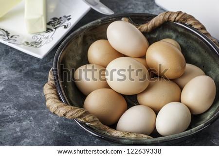 Bowl of fresh free range brown chicken eggs ready for baking - stock photo