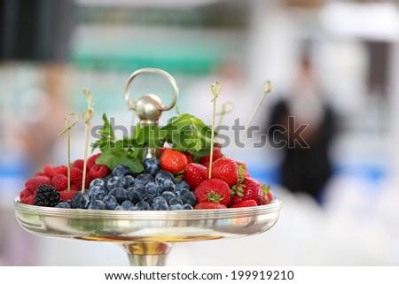 Bowl of fresh fruits. Shallow DOF - stock photo