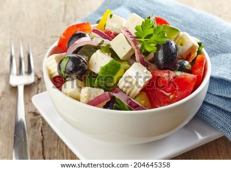 bowl of fresh greek salad - stock photo