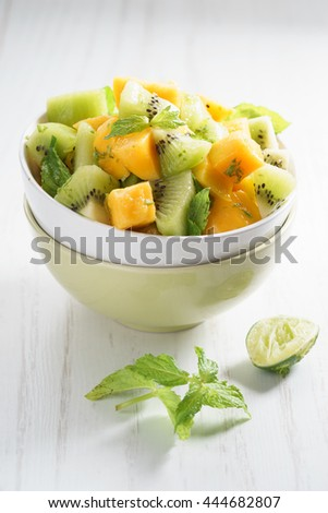 bowl of fresh healthy fruit salad, mango and kiwi