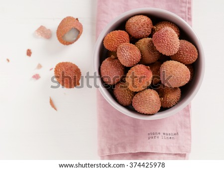 Bowl of fresh lychee fruit, shot from above. (Litchi chinensis)  - stock photo