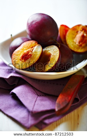 Bowl of fresh plums - stock photo
