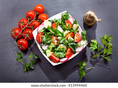 bowl of fresh salad on a dark background