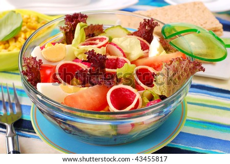 bowl of fresh salad with salami,eggs and vegetables