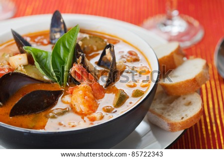 Bowl of fresh seafood soup - stock photo