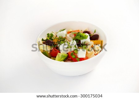 Bowl of fresh summer sliced vegetables greek salad isolated at white background. - stock photo