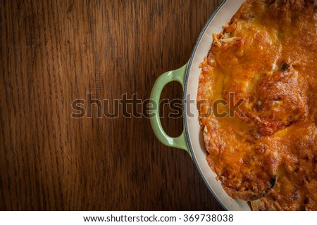 Bowl of Freshly baked nachos covered with melted cheese - stock photo