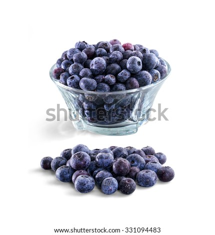 Bowl of frozen domestic blueberries isolated on white background with clipping path