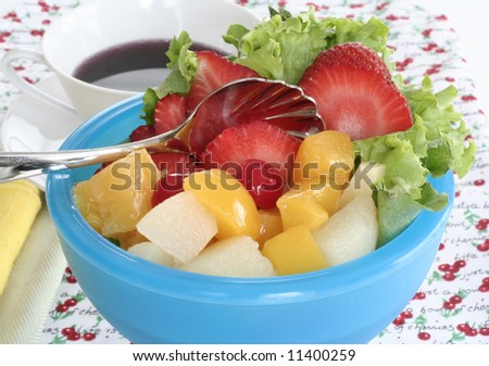 Bowl of fruit and cup of coffee