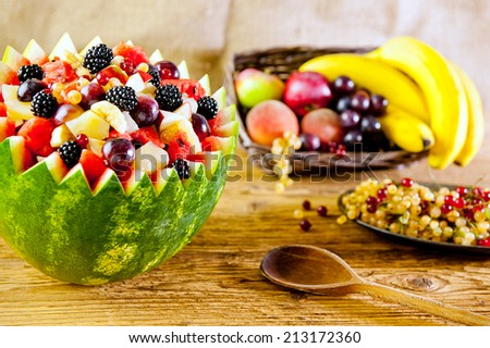 bowl of fruit salad - Focus in the middle of the fruit salad - stock photo