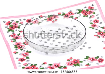 Bowl of glass on cloth - stock photo