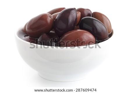 Bowl of  Greek Kalamata olives. Isolated on white. - stock photo