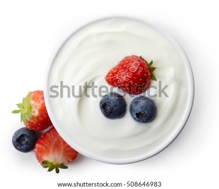 Bowl of greek yogurt and fresh berries isolated on white background from top view
